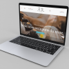 mockup-of-a-silver-macbook-air-over-a-solid-surface-23684